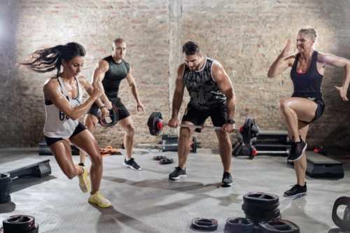 sporty people  practicing with weights